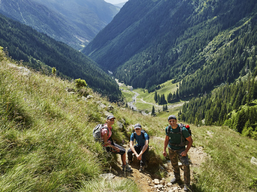 45289714 - group of hikers on a trail in the mountains in a beautiful scenery