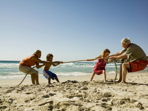 Children and grandparents playing tug of war.