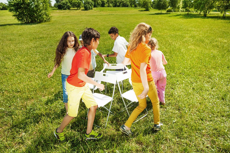 30375473 - kids run around playing musical chairs game